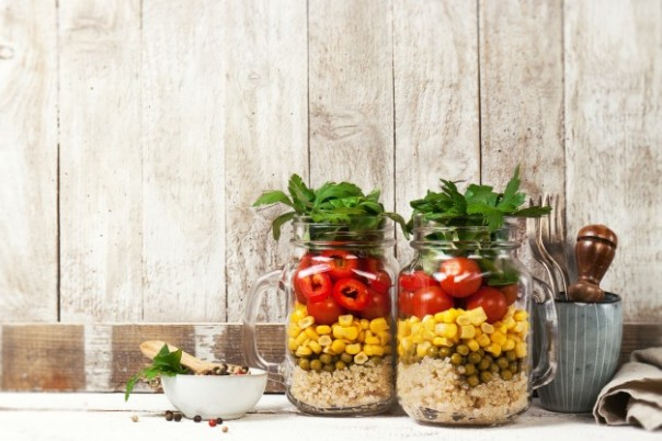 homemade-healthy-layer-salad-in-mason-jars-on-a-wooden-backgroun_1220-784